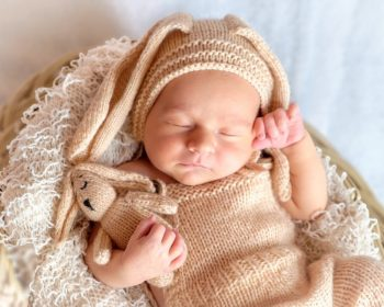 Cute Newborn in crocheted bunny outfit