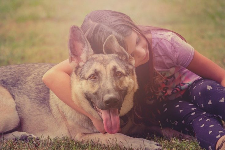 girl with family dog