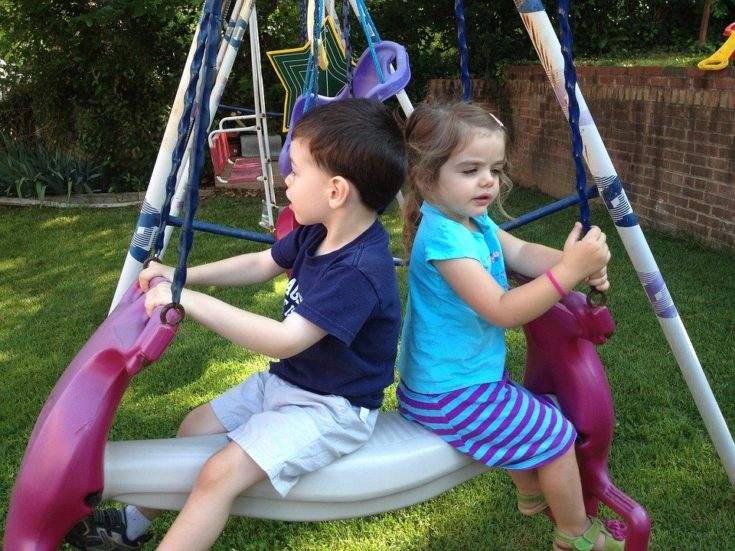 kids on swing at daycare